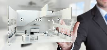 Businessman touching white 3D rendering apartment with his finge. Businessman on blurred background touching white 3D rendering apartment with his finger Royalty Free Stock Photos