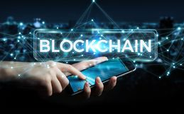 Businessman using blockchain cryptocurrency interface 3D renderi. Businessman on blurred background using blockchain cryptocurrency interface 3D rendering Stock Images