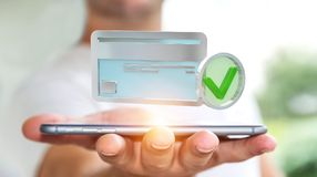 Businessman using credit card to pay online 3D rendering. Businessman on blurred background using credit card to pay online 3D rendering Stock Image