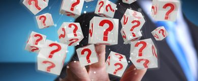 Businessman using cubes with 3D rendering question marks. Businessman on blurred background using cubes with 3D rendering question marks Stock Photos