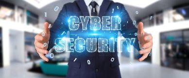 Businessman using cyber security text hologram 3D rendering. Businessman on blurred background using cyber security text hologram 3D rendering Royalty Free Stock Photo