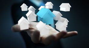 Businessman using 3D rendered small white and blue houses. Businessman on blurred background using 3D rendered small white and blue houses Stock Photography