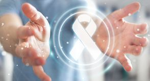 Businessman using digital ribbon cancer interface 3D rendering. Businessman on blurred background using digital ribbon cancer interface 3D rendering Stock Photo
