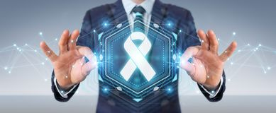 Businessman using digital ribbon cancer interface 3D rendering. Businessman on blurred background using digital ribbon cancer interface 3D rendering Royalty Free Stock Photos