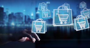 Businessman using digital shopping icons 3D rendering. Businessman on blurred background using digital shopping icons 3D rendering Royalty Free Stock Image