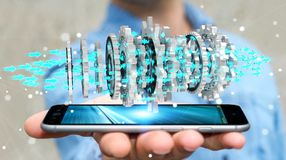 Businessman using floating modern gear mechanism 3D rendering. Businessman on blurred background using floating gear icons over phone 3D rendering Stock Photography