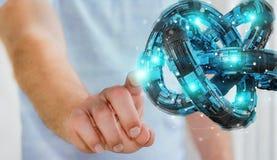 Businessman using futuristic torus textured object 3D rendering. Businessman on blurred background using futuristic torus textured object 3D rendering Stock Image