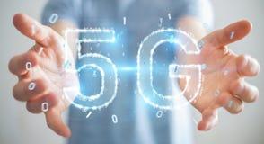 Businessman using 5G network digital hologram 3D rendering. Businessman on blurred background using 5G network digital hologram 3D rendering Stock Photos