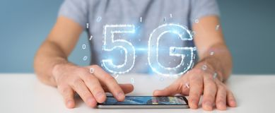 Businessman using 5G network digital hologram 3D rendering. Businessman on blurred background using 5G network digital hologram 3D rendering Stock Photo