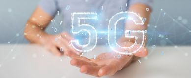 Businessman using 5G network digital hologram 3D rendering. Businessman on blurred background using 5G network digital hologram 3D rendering Royalty Free Stock Image