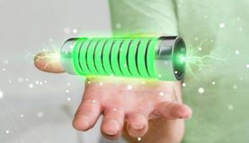 Businessman using green battery with lightnings 3D rendering. Businessman on blurred background using green battery with lightnings 3D rendering Stock Photography