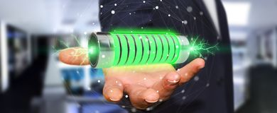 Businessman using green battery with lightnings 3D rendering Royalty Free Stock Image