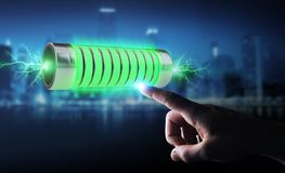 Businessman using green battery with lightnings 3D rendering Royalty Free Stock Photo