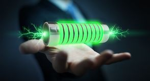 Businessman using green battery with lightnings 3D rendering. Businessman on blurred background using green battery with lightnings 3D rendering Royalty Free Stock Photos