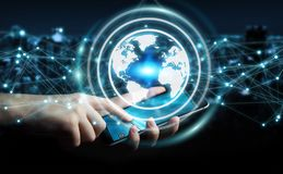 Businessman using planet earth network sphere 3D rendering. Businessman on blurred background using planet earth network with mobile phone 3D rendering Royalty Free Stock Photos