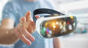 Businessman using virtual reality glasses technology 3D renderin. Businessman on blurred background using virtual reality glasses technology 3D rendering Stock Images