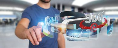Businessman using virtual reality glasses technology 3D renderin. Businessman on blurred background using virtual reality glasses technology 3D rendering Royalty Free Stock Photo