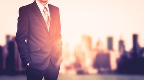 Businessman on blurred city background. Effect of sunlight royalty free stock photos