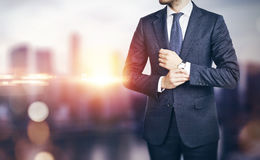 Businessman on blurred city background Stock Images