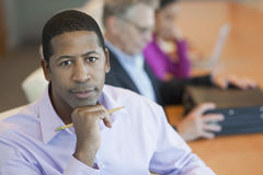 Businessman With Blurred Multiethnic Colleagues Stock Photography