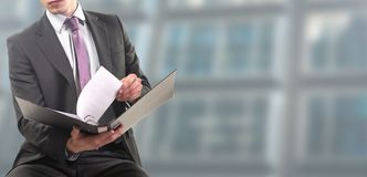 Businessman consults folders on a ring binder royalty free stock photo