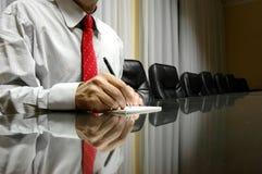 Businessman in board room. Businessman writing on blank paper in board room, business concept Stock Photo