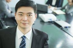 Businessman in Board Room stock image