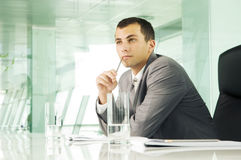 A businessman in a boardroom Stock Photos