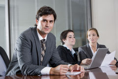 Businessman in boardroom with female colleagues Royalty Free Stock Image