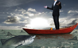 Businessman on a boat Stock Photo