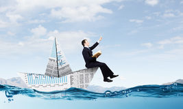 Businessman in boat made of paper Stock Photo