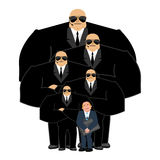Businessman with bodyguards. VIP protection. Black suit and hand Stock Photos