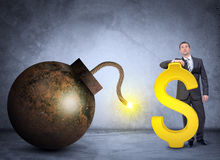 Businessman with bomb and dollar sign Royalty Free Stock Photography