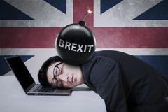 Businessman with bomb and UK flag Stock Photos