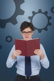 Businessman with book. Businessman holding book and gears over head Royalty Free Stock Photos