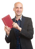 Businessman with a book. isolated Stock Photography