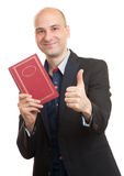 Businessman with a book. isolated Royalty Free Stock Photos