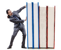 Businessman with books Stock Photo