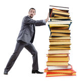 Businessman with books Stock Photos