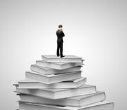 Businessman and books Royalty Free Stock Photography