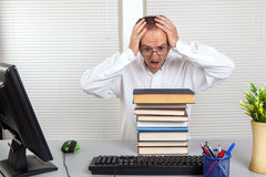 Businessman and books Stock Photography