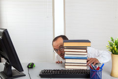 Businessman and books Stock Photos