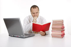 Businessman with books and laptop Stock Photo