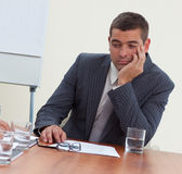 Businessman bored in a meeting Stock Photos