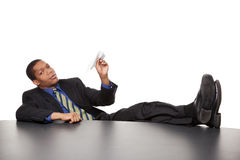 Businessman - bored paper airplane Stock Image