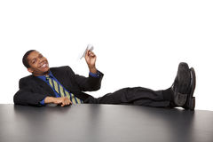 Businessman - bored paper airplane Royalty Free Stock Photography