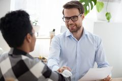 Black woman successfully passed interview handshake in office stock photo