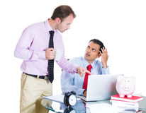 Businessman boss checking on his employee, working hard on a project on computer Royalty Free Stock Photography