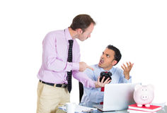 Businessman boss checking on his employee, working hard on a project on computer Stock Image