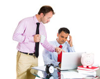 Businessman boss checking on his employee, working hard on a project on computer, and is in disagreement with boss Stock Images